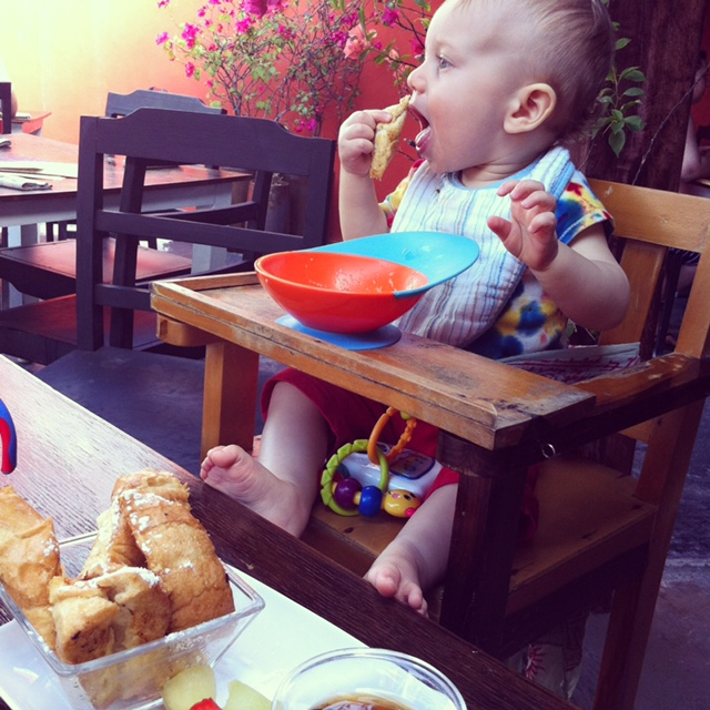 Toddler eating with Boon Catch bowl in Mexico