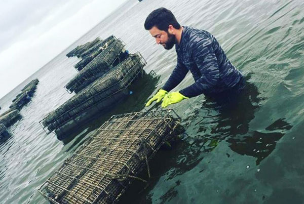 Lew Childre farming oysters in Gulf Shores, Alabama