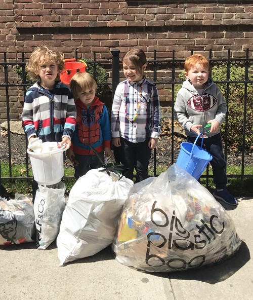Kids collecting garbage on the sidewalks of NYC.