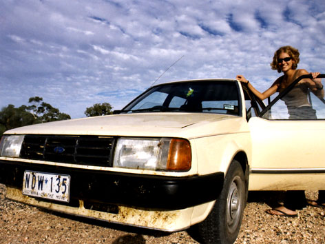 Female and a car, on a road trip