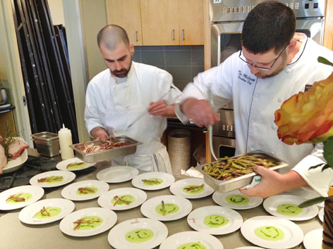 Chef Tim McGrath plating dishes at a NYC culinary event
