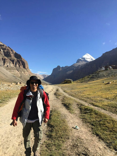 A young tour guide hiking in Tibet.