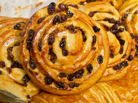 A pile of fresh chelsea buns from The Flour Station in London, England.