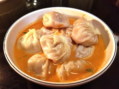 A bowl of momo jhol achar, or momo dumplings in soup, from Kathmandu
