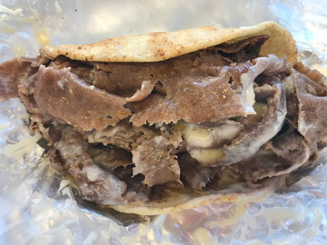 A classic donair in pita bread with white sauce from Tony's in Halifax, Nova Scotia