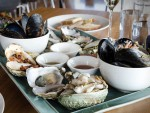 A spread of local Tasmanian oysters and shellfish from Bangor Wine and Oyster Shed in Hobart, Tasmania.