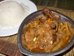 A plate of yassa poulet with rice from Point d'Interrogation in Dakar, Senegal.